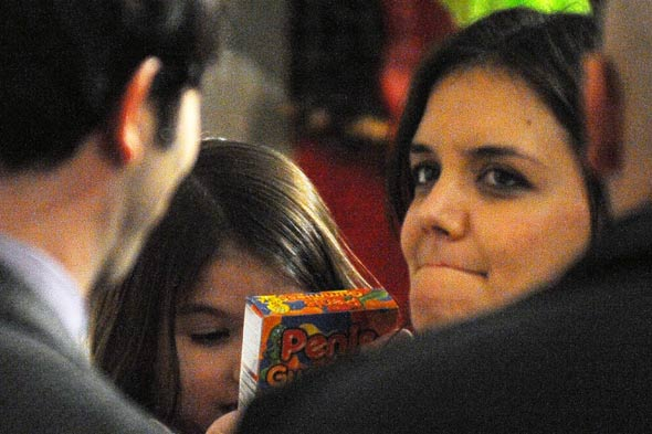 Suri Cruise eyes up penis shaped sweets
