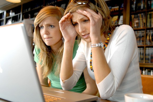 Teen girls looking at laptop