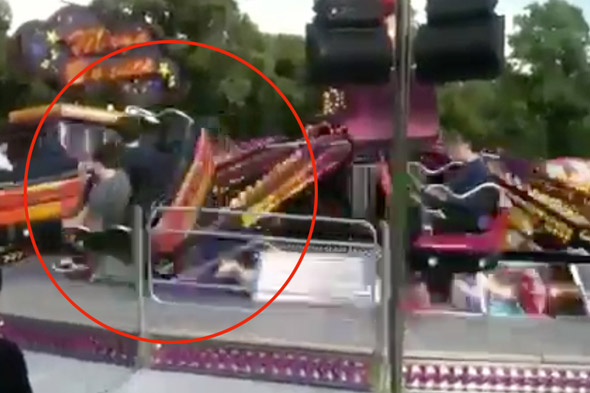Terrifying video: Moment two teenagers are seriously hurt as fairground ride spins off mechanics and flips over is caught on camera