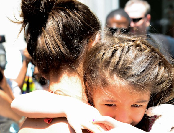 Is Suri Cruise going to be brought up as a Catholic by Katie Holmes?