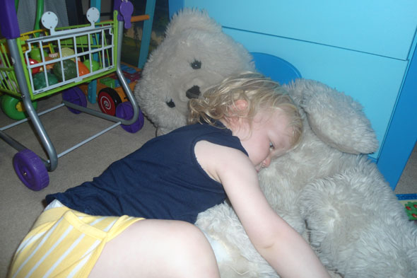 Diana from Toddler Tales cuddling her favourite soft toy