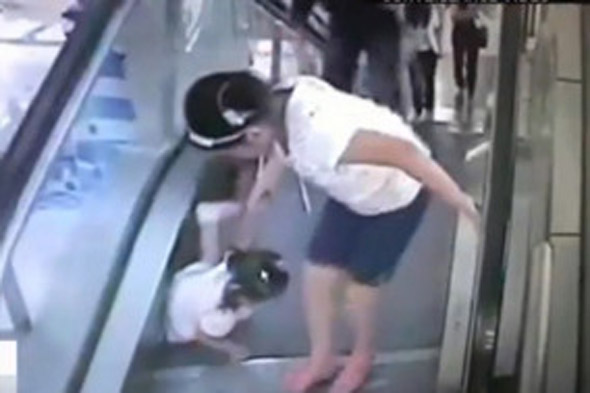 Toddler gets finger stuck in escalator