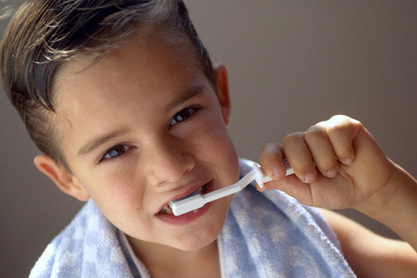 Is 'healthy' fruit juice rotting your child's teeth? Child brushing teeth