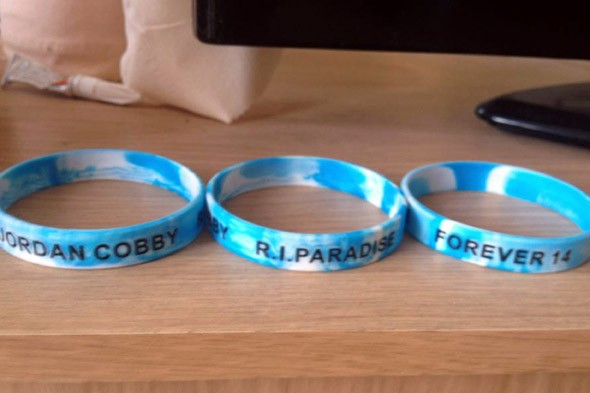 Friends of schoolboy who died from cancer are banned from wearing charity wristbands in his memory