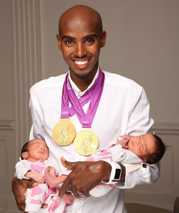 Mo Farah holds twin girls Amani and Aisha