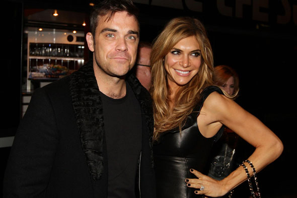 Robbie Williams 'sick' of gossip about new baby daughter