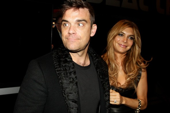 Robbie Williams reveals his back-to-work plans - baby Teddy will go with him!