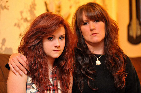 Girl suspended from school for 'unnatural' dyed red hair