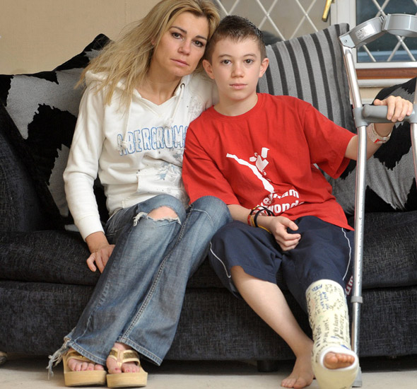Boy, 12, is crushed by half-tonne gate - and escapes with a broken leg