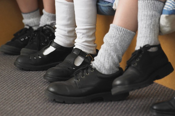 School clamps down on kids wearing black plimsolls