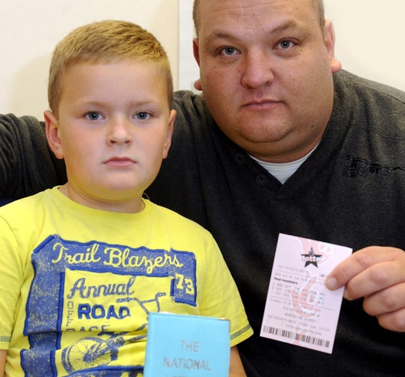 Dad refused Lottery tickets because his son, 8, was with him