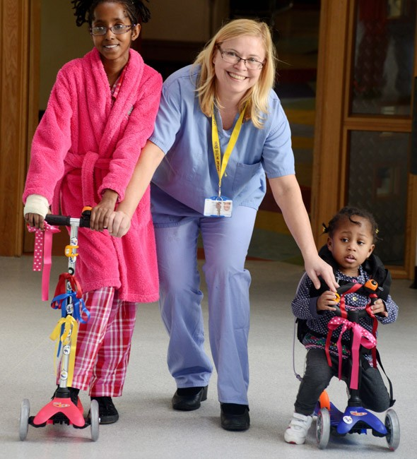 Kids' scooters allow young patients a fun journey down to the operating theatre