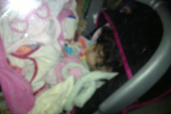 Police find baby buried beneath pile of rubbish in 'drunk' and 'drugged' woman's car