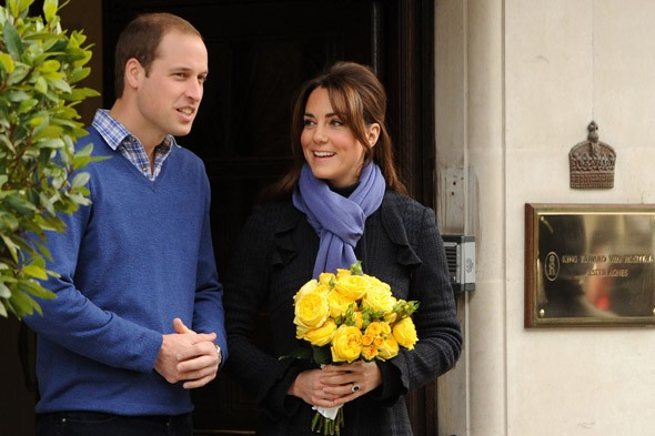 Smiling Duchess of Cambridge leaves hospital with Prince William by her side