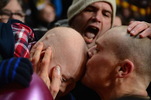Brave brain tumour boy gets victory kiss from his Bradford City cup hero Gary Jones