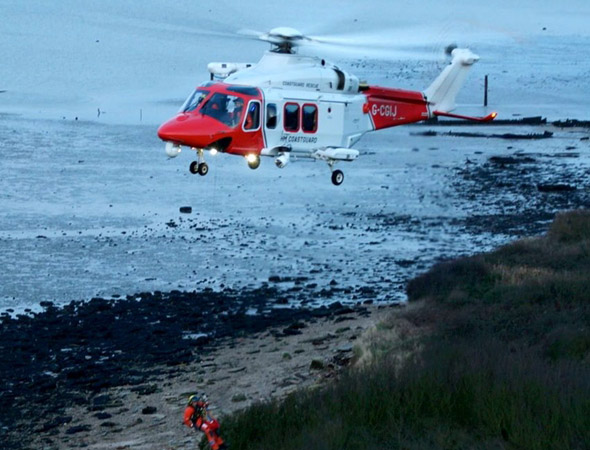 Grieving boy rescued by helicopter after sinking in mud where his grandfather's ashes were scattered