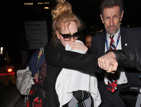 Adele's dad pleads with his daughter to heal family rift so he can see his grandson
