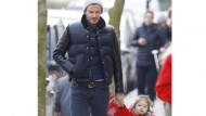 Daddy daycare: Harper and David Beckham step out in matching jackets