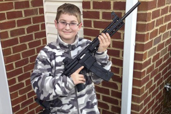 Dad's Facebook photo of 10-year-old son posing with hunting rifle provokes child abuse tip-off