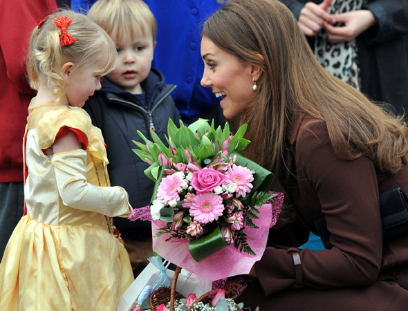 Pregnant Duchess of Cambridge greets crowds in Grimsby - after arriving by helicopter!
