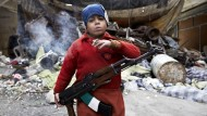 Children at war: The shocking photo of Syrian boy soldier aged 7