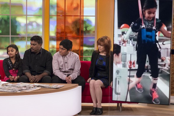 Britain's youngest gun-crime victim learns to walk again
