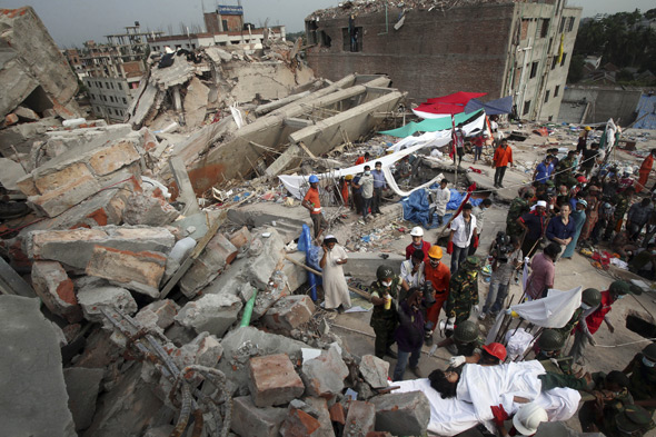 Woman gives birth trapped under rubble at Bangladesh clothing factory collapse