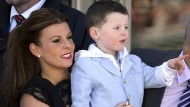 Eight months pregnant Coleen Rooney in lace and teetering heels