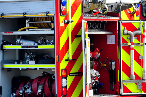 Fire-crews called to rescue girl stuck between a wall and a container