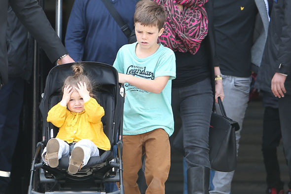 Harper Beckham gets a push from big brother Cruz on family day out