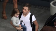 Big brother Brooklyn Beckham takes strain off mum by carrying Harper