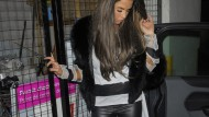 Four months pregnant Katie Price asleep on her feet outside a nightclub - at 2am
