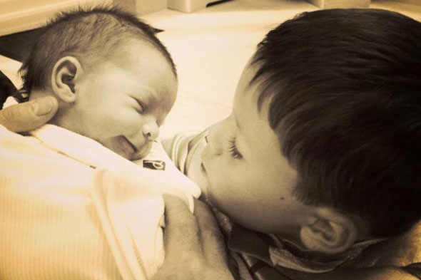 Proud mum Coleen Rooney shares intimate photo of Klay and Kai
