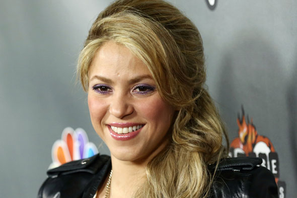 Why Shakira is putting her small and humble breasts to extented use...