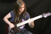 Watch in awe as bored teenage girl performs mind-boggling Van Halen guitar solo