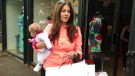 Imogen Thomas juggles shopping bags with motherhood