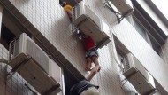 Miracle escape as boy falls from fourth floor window