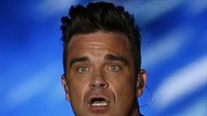'Dad-sized' but happy - Robbie Williams says fatherhood has made him content