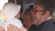 Elton John gives baby Elijah the giggles
