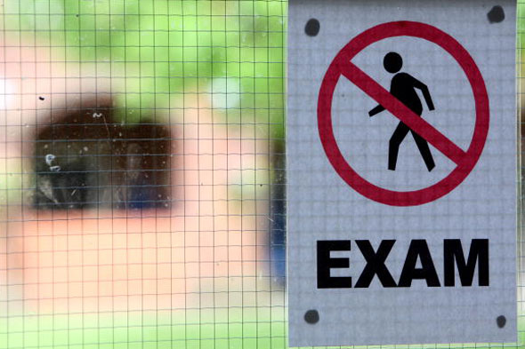 Teachers at 'outstanding' college accused of 'leading' pupils through exams