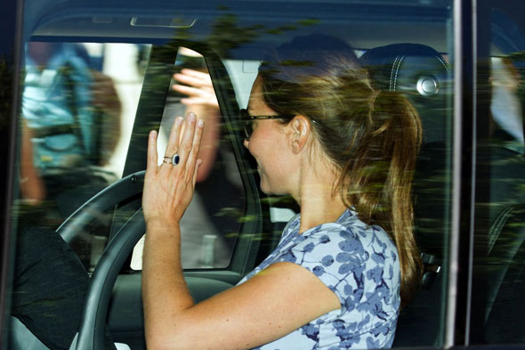First pictures of the Royal Baby: Kate and William leave hospital with their new son