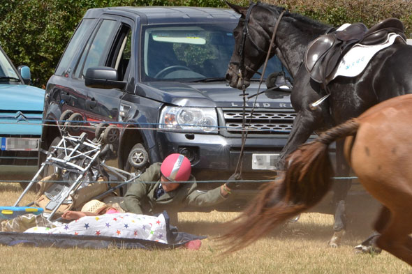 Pictures: The terrifying moment a horse bolts into pushchair at country fair