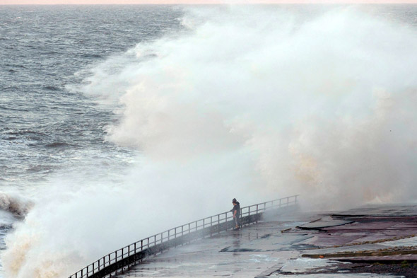 Teens play 'chicken' with 50ft high North Sea waves
