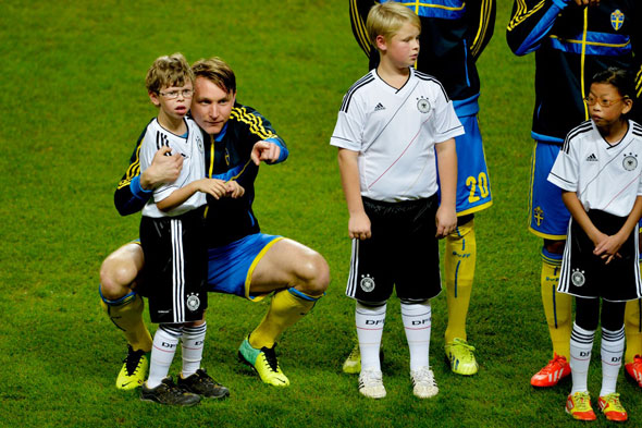 Touching moment goes viral: Footballer comforts little autistic mascot boy