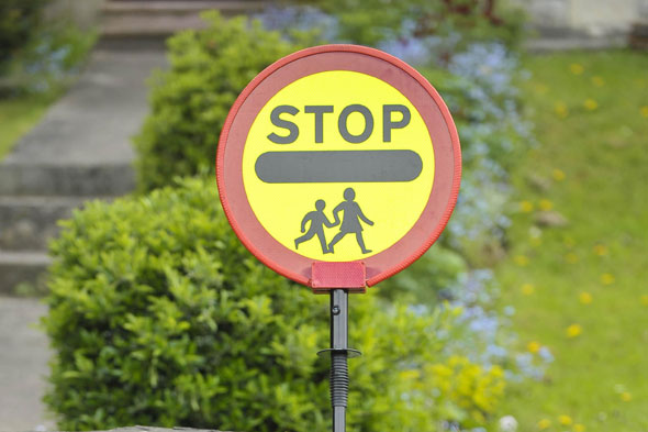 Lollipop man quits after being threatened with suspension for high-fiving kids