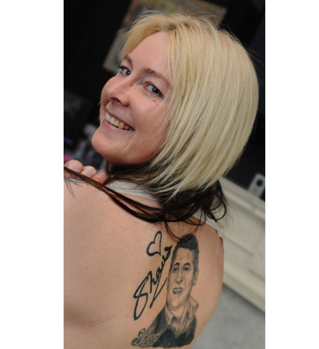 Mum get Shane Richie's grinning face tattooed across her back