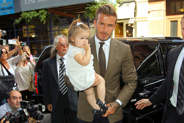 Harper Beckham is honing her footballs skills with her big brothers