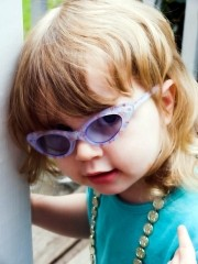 A young girl wearing sunglasses