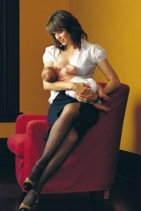 Lucy Lawless, former star of Xena, Warrior Princess, breastfeeding in a poster to promote world breastfeeding week.