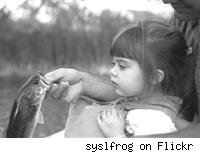 girl looking at fish